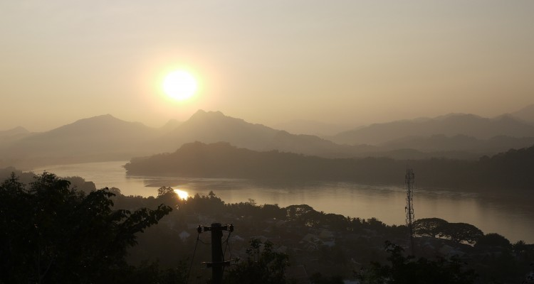 The sun sets over the Mekong River north of the Swai breading grounds near Luang Prabang, Laos. Towns like Luang Prabang now face a changing ecosystem by the Mekong, as species disappear and the river changes from damming operations. Photo: Shannon O'Donnell, alittleadrift.com.